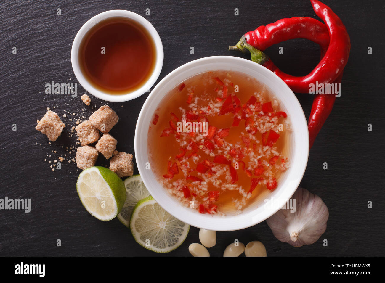 Vietnamese spicy sauce Nuoc Cham with the ingredients in a bowl close-up. horizontal view from above - Stock Image