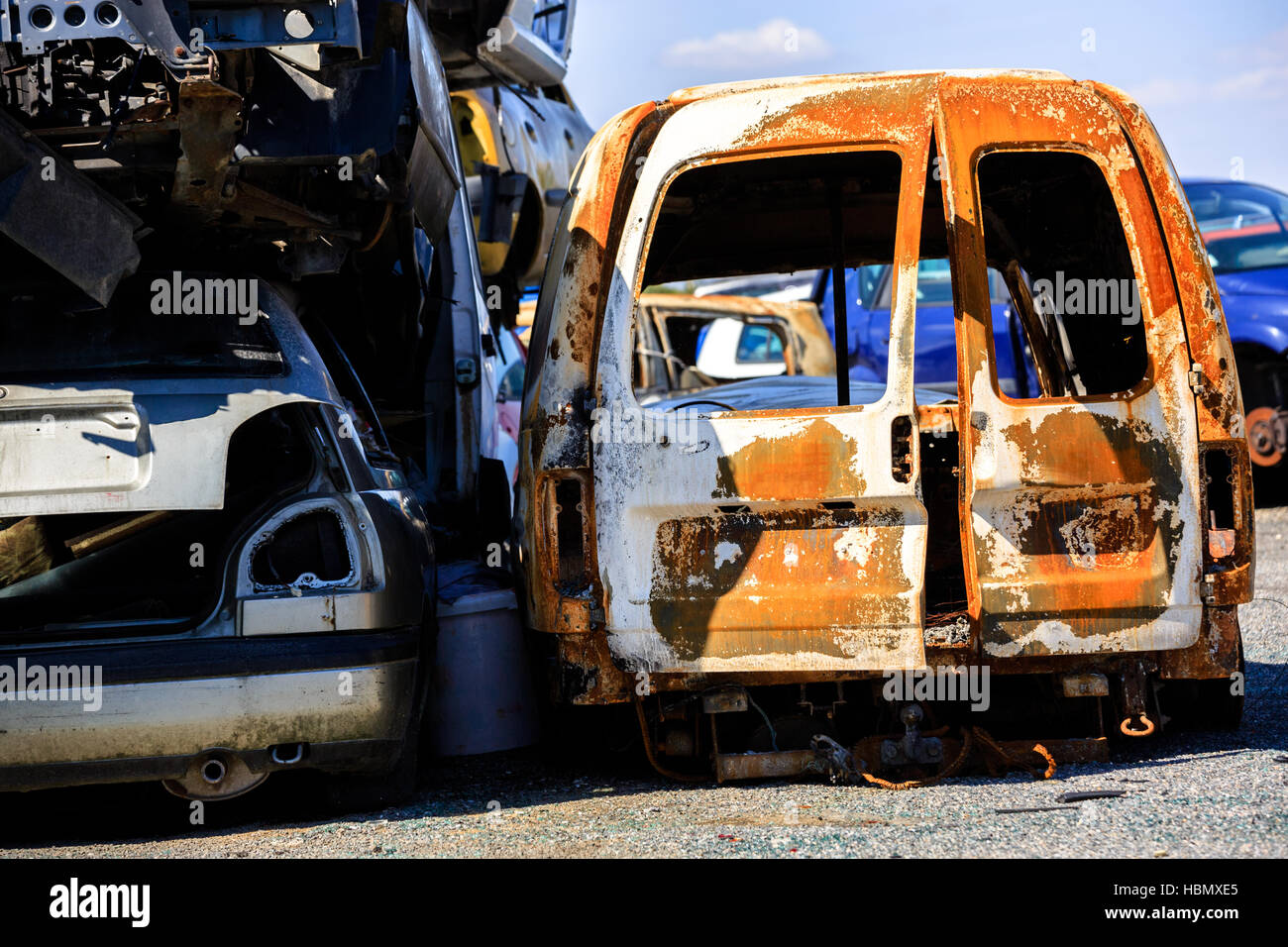 A scrap yard and car dump with wrecked Stock Photo