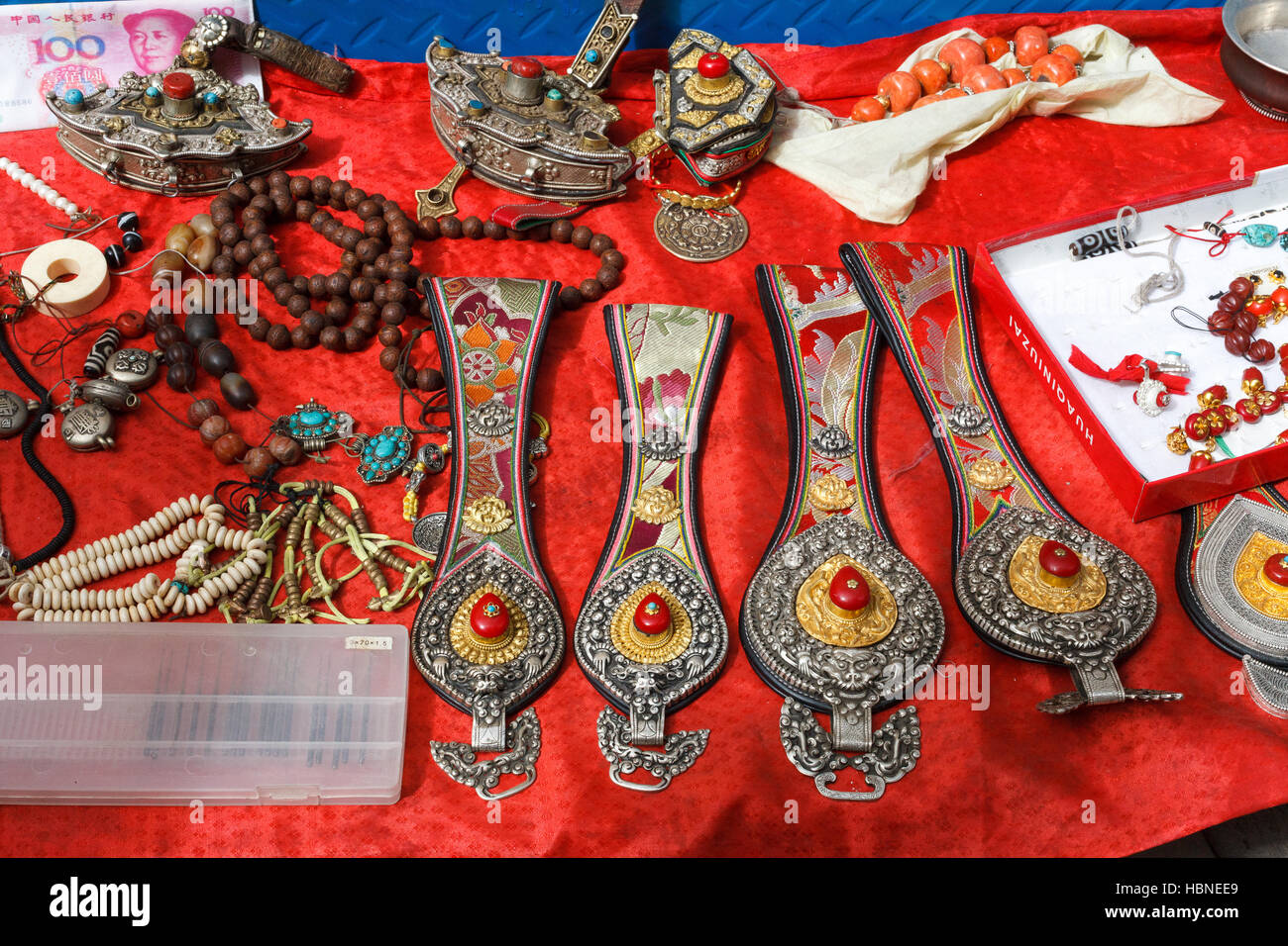 Tibetan accessories sold on the market - Stock Image