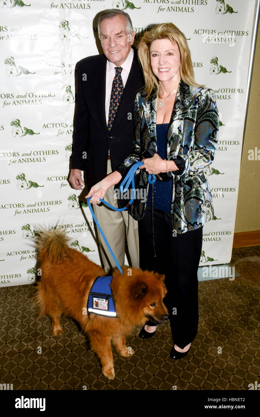 Peter Marshall, Laurie Marshall and their service dog Teddy Bear arrives at the Actors And Others For Animals' - Stock Image