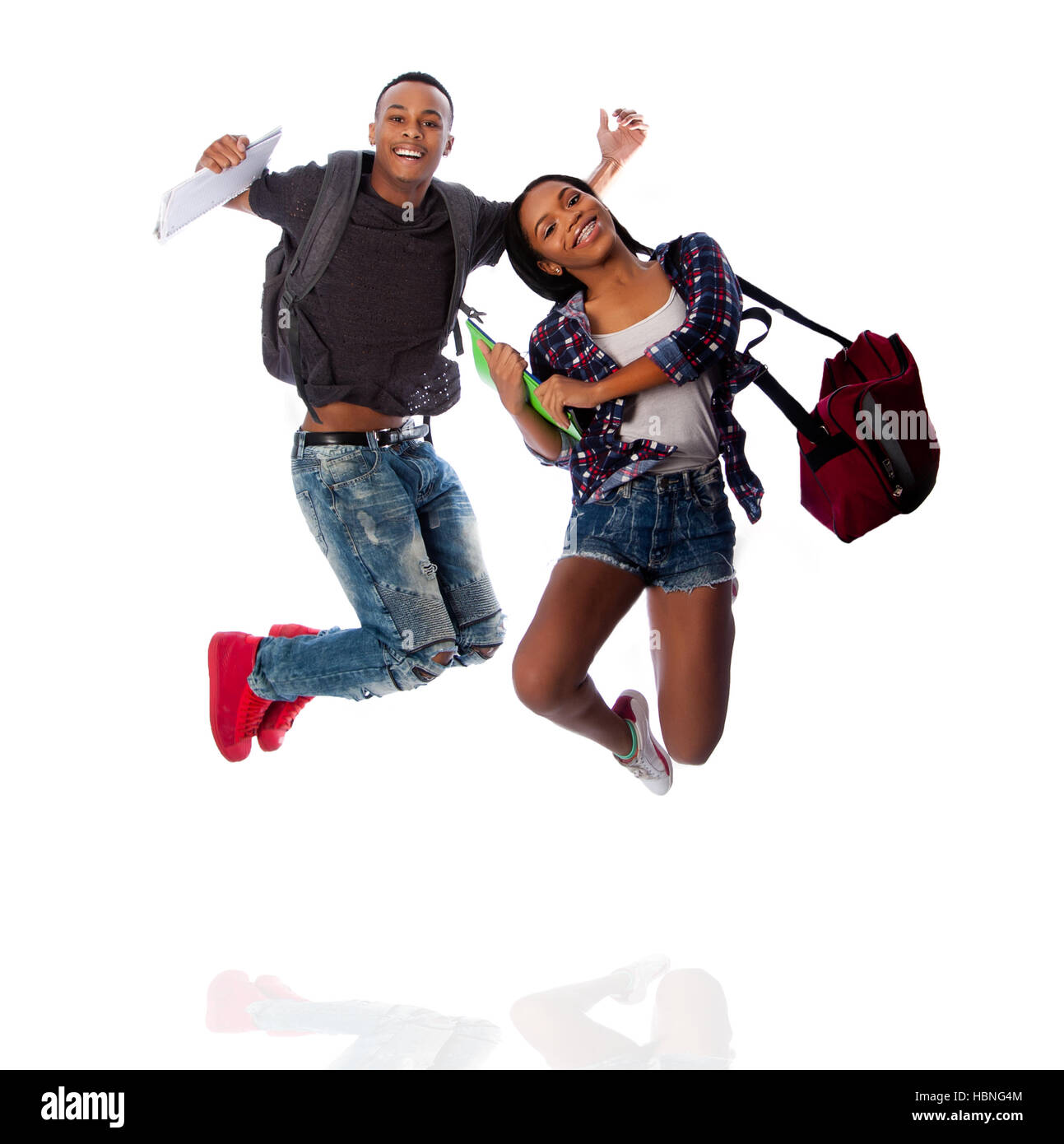 Two happy students jumping of happiness - Stock Image