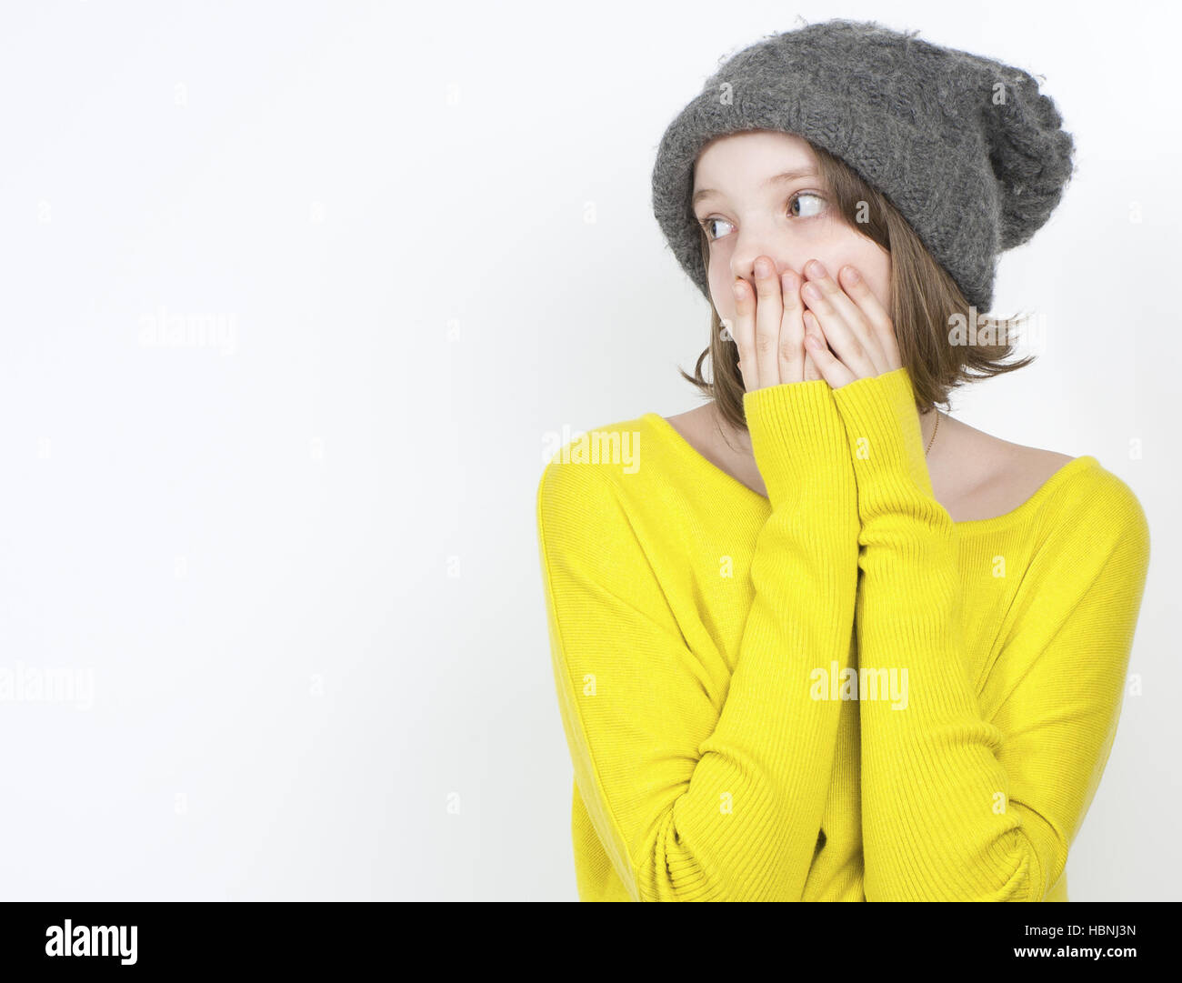 Frightened girl looking to the side. - Stock Image