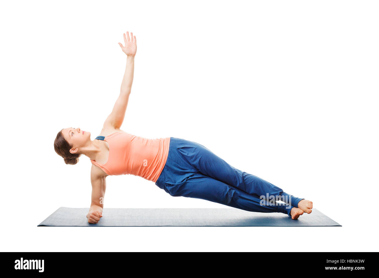 Woman doing yoga asana Vasisthasana - side plank pose - Stock Image