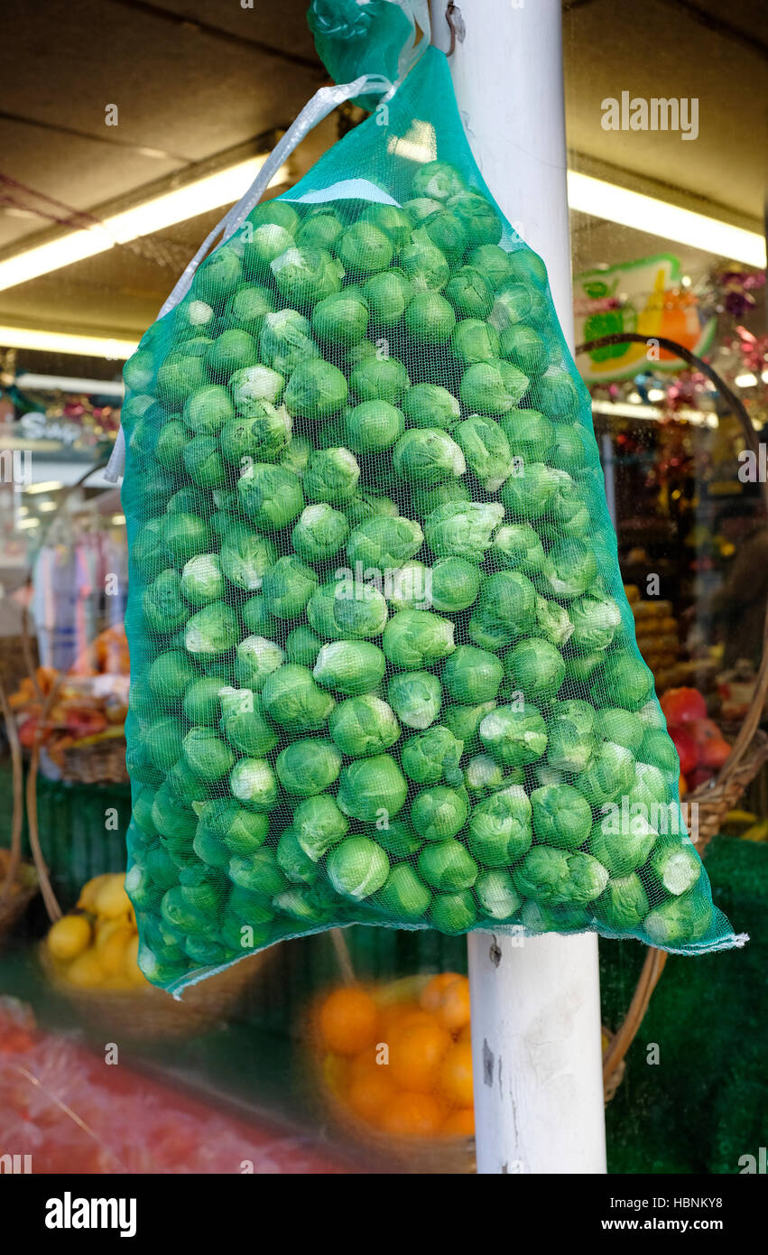 large bag of brussel sprouts outside greengrocer's shop Stock Photo