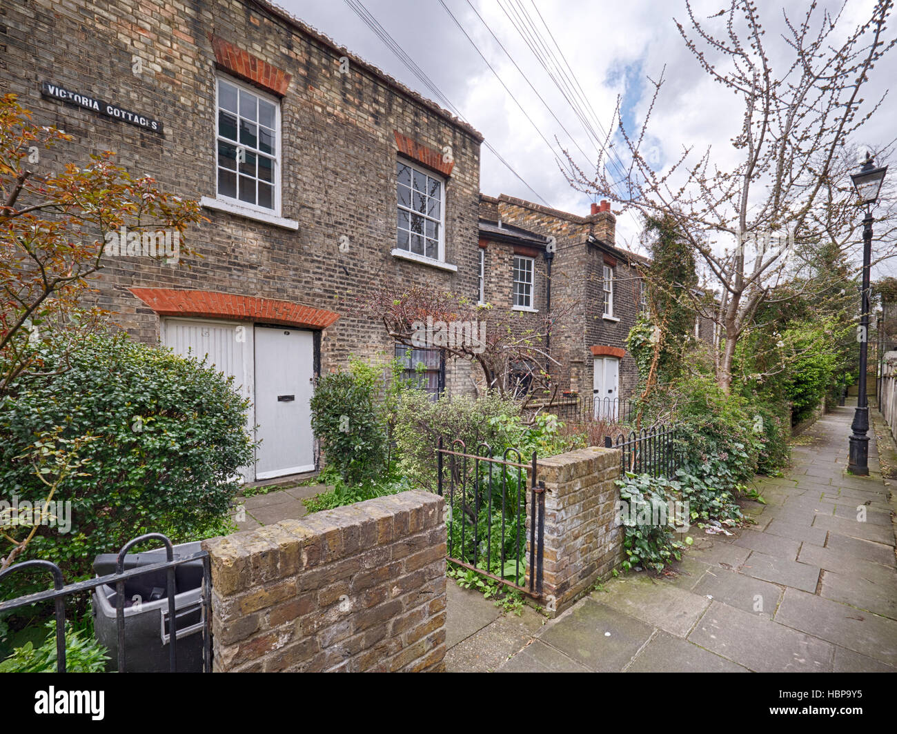 Victoria Cottages, Whitechapel an example of early philanthropic social housing built in 1858 - Stock Image