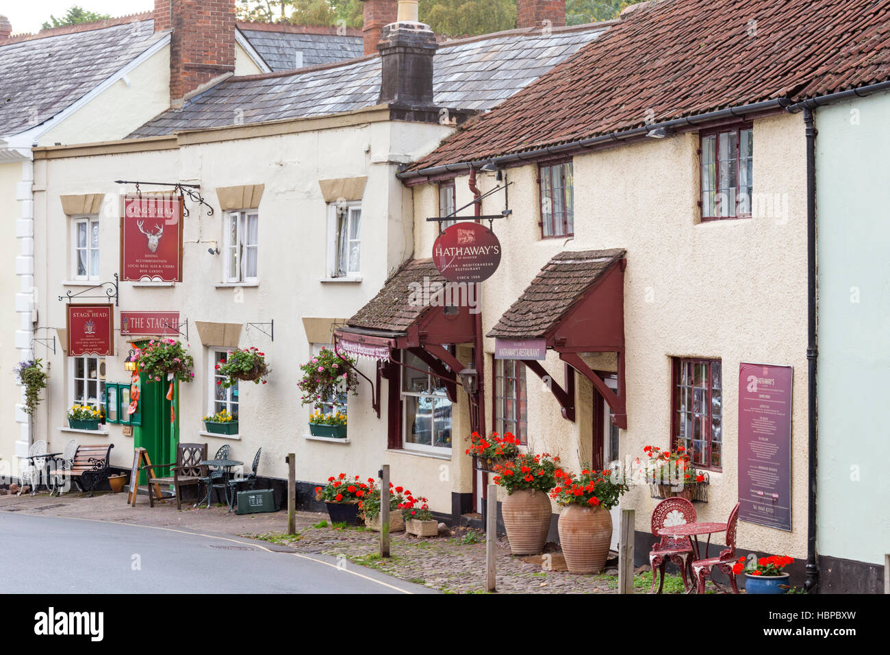 Historic pubs and shops in Dunster village near Minehead, Somerset, England, UK - Stock Image