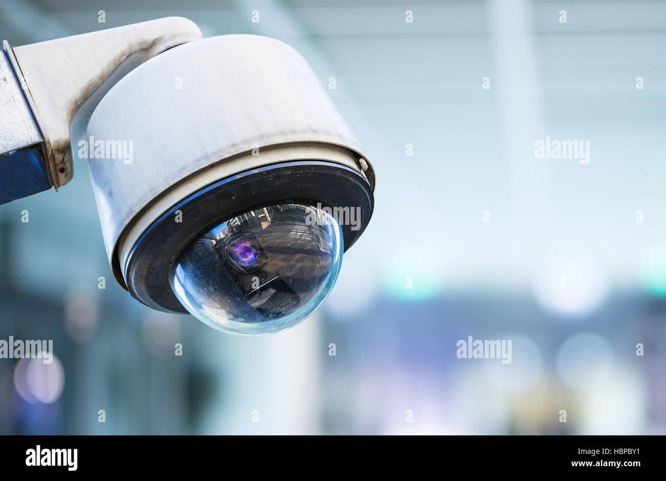 CCTV security camera with blurred background - Stock Image