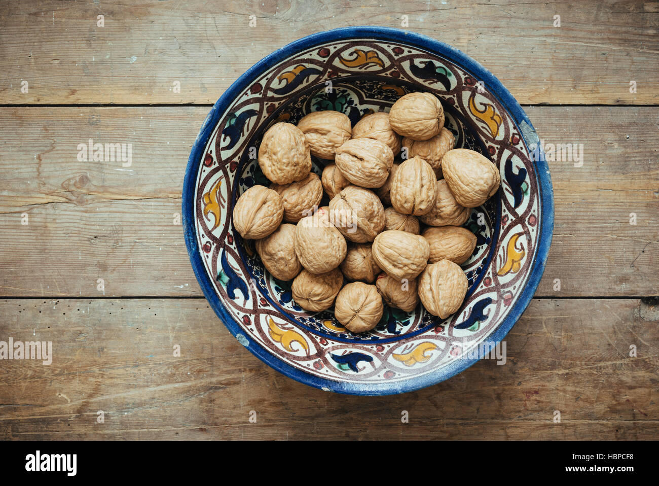 Walnuts in a Moroccan bowl - Stock Image