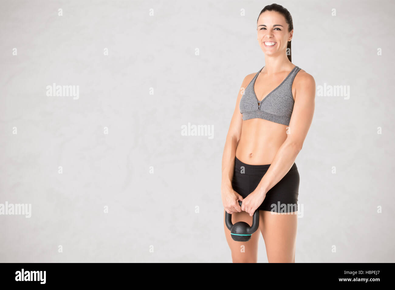 Woman Working Out With a Kettlebell - Stock Image