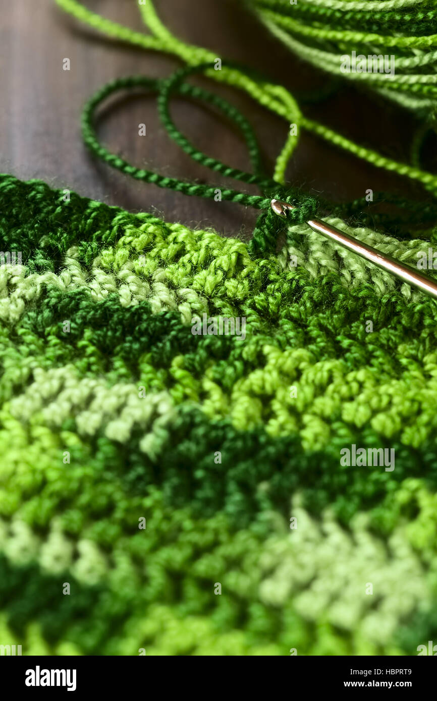 Crochet Handicraft Making A Place Mat Out Of Green Yarn With A