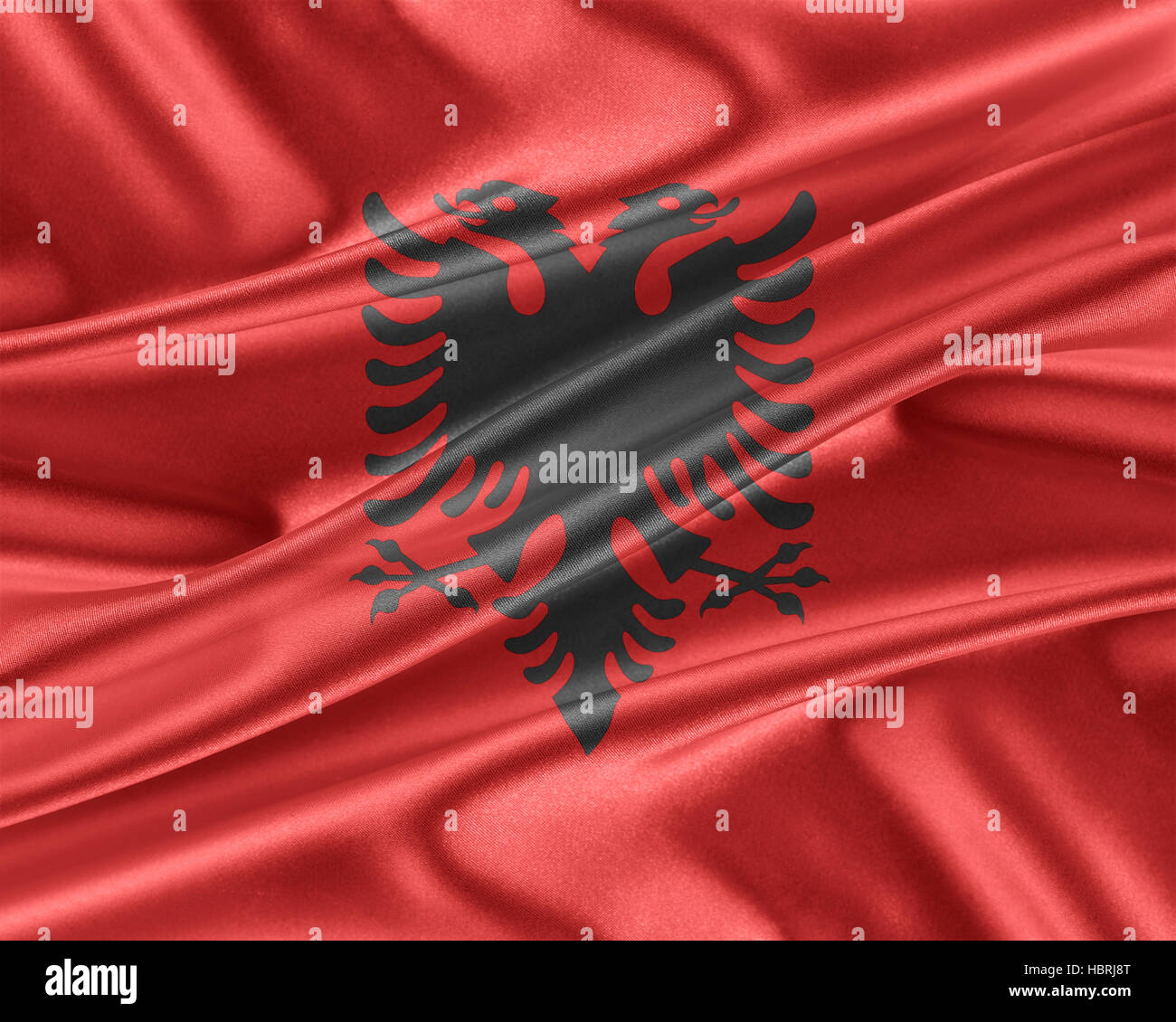 Albania flag with a glossy silk texture. - Stock Image