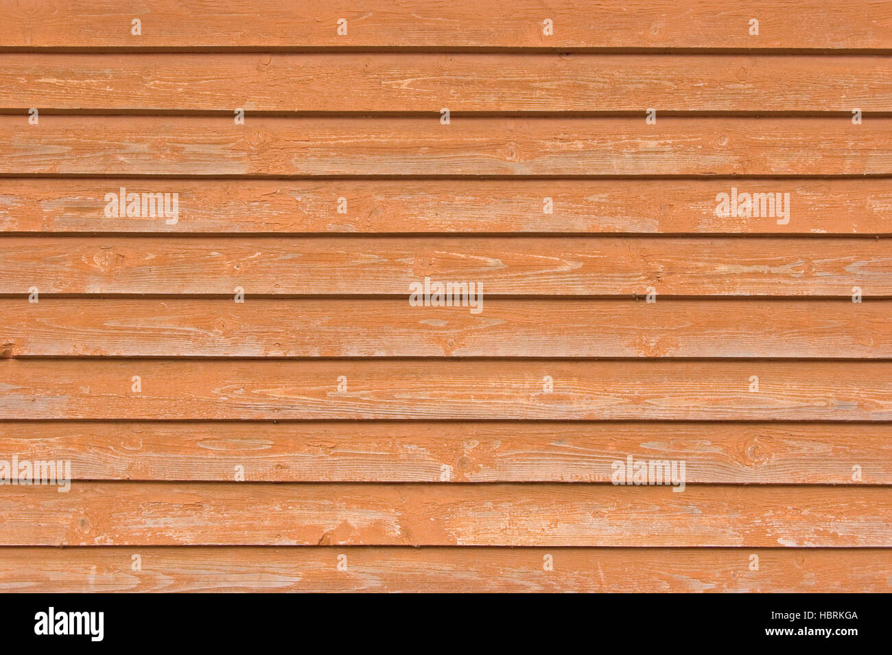Natural old wood fence planks, wooden close board texture, overlapping light reddish brown horizontal closeboard - Stock Image