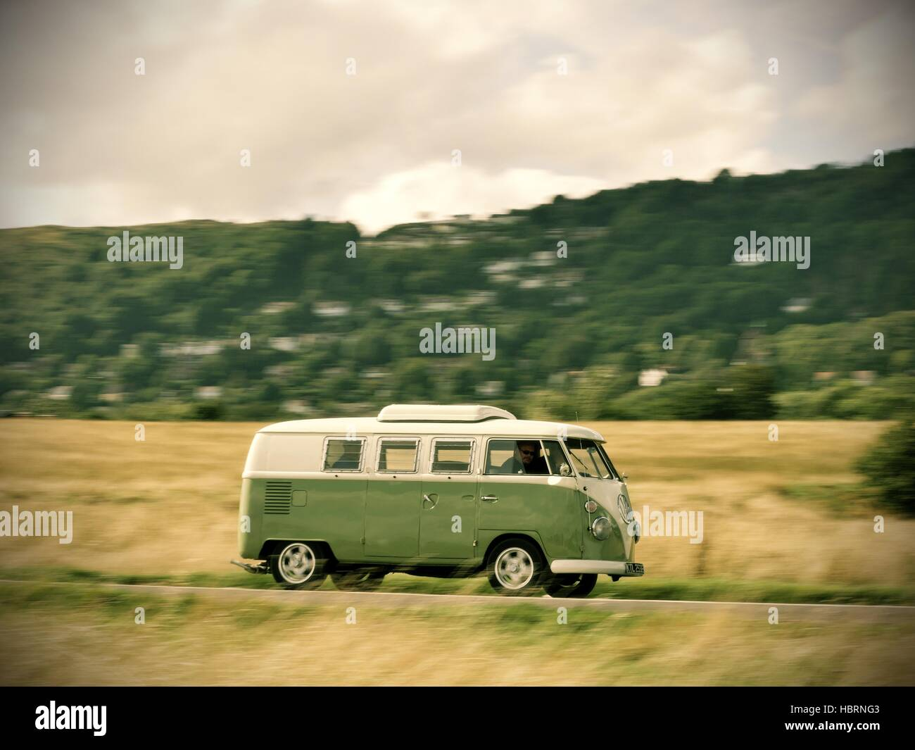 speeding green two tone split screen volkswagen campervan near the Malvern Hills Worcestershire UK - Stock Image