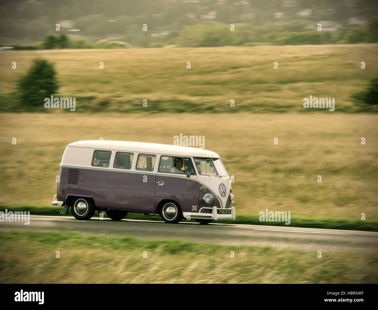 speeding two tone split screen volkswagen campervan near the Malvern Hills Worcestershire UK - Stock Image