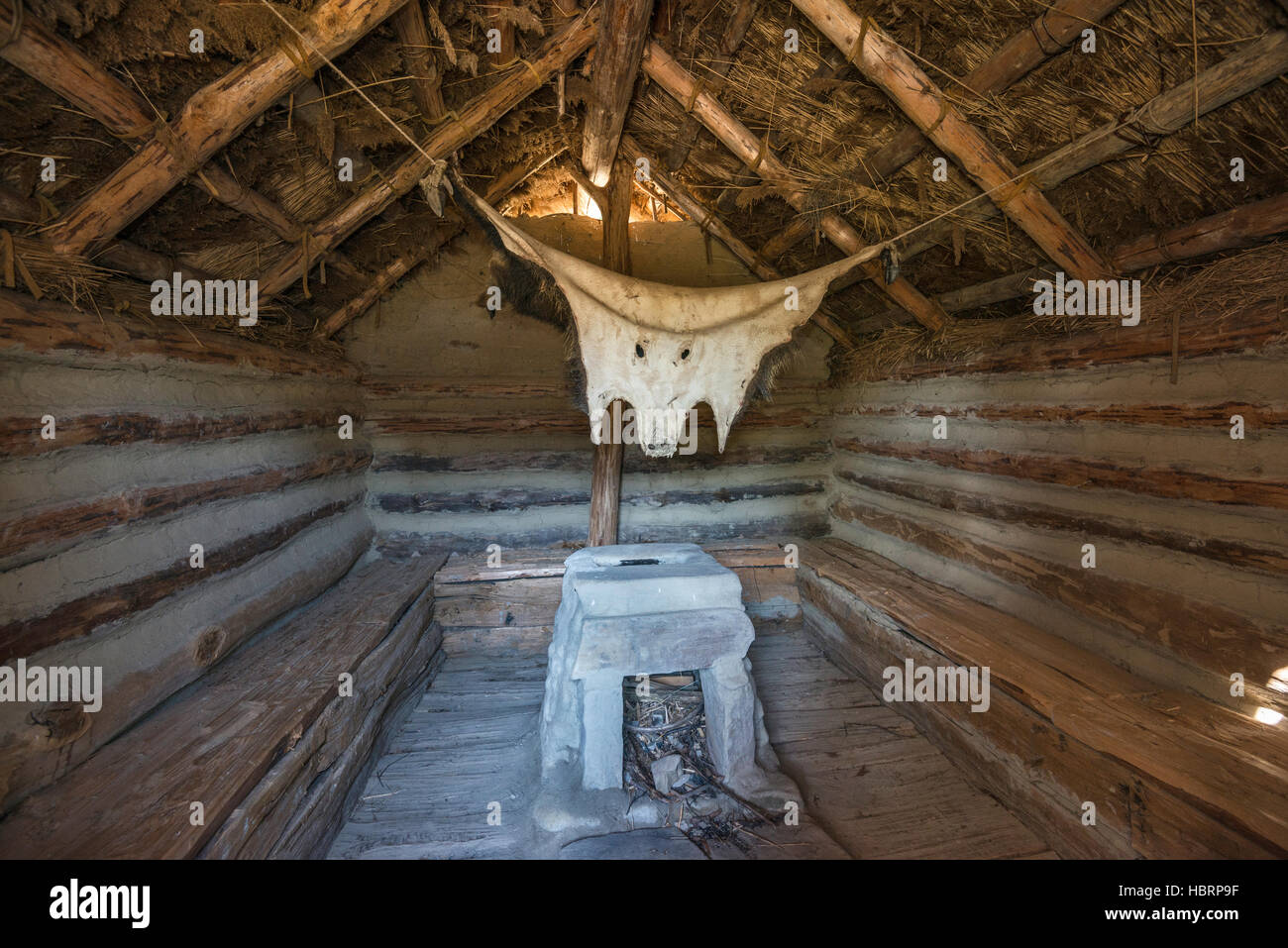 Semi-recessed log cottage, 8th-10th century, reconstruction, Carpathian Troy Archaeological Open-Air Museum in Trzcinica, - Stock Image