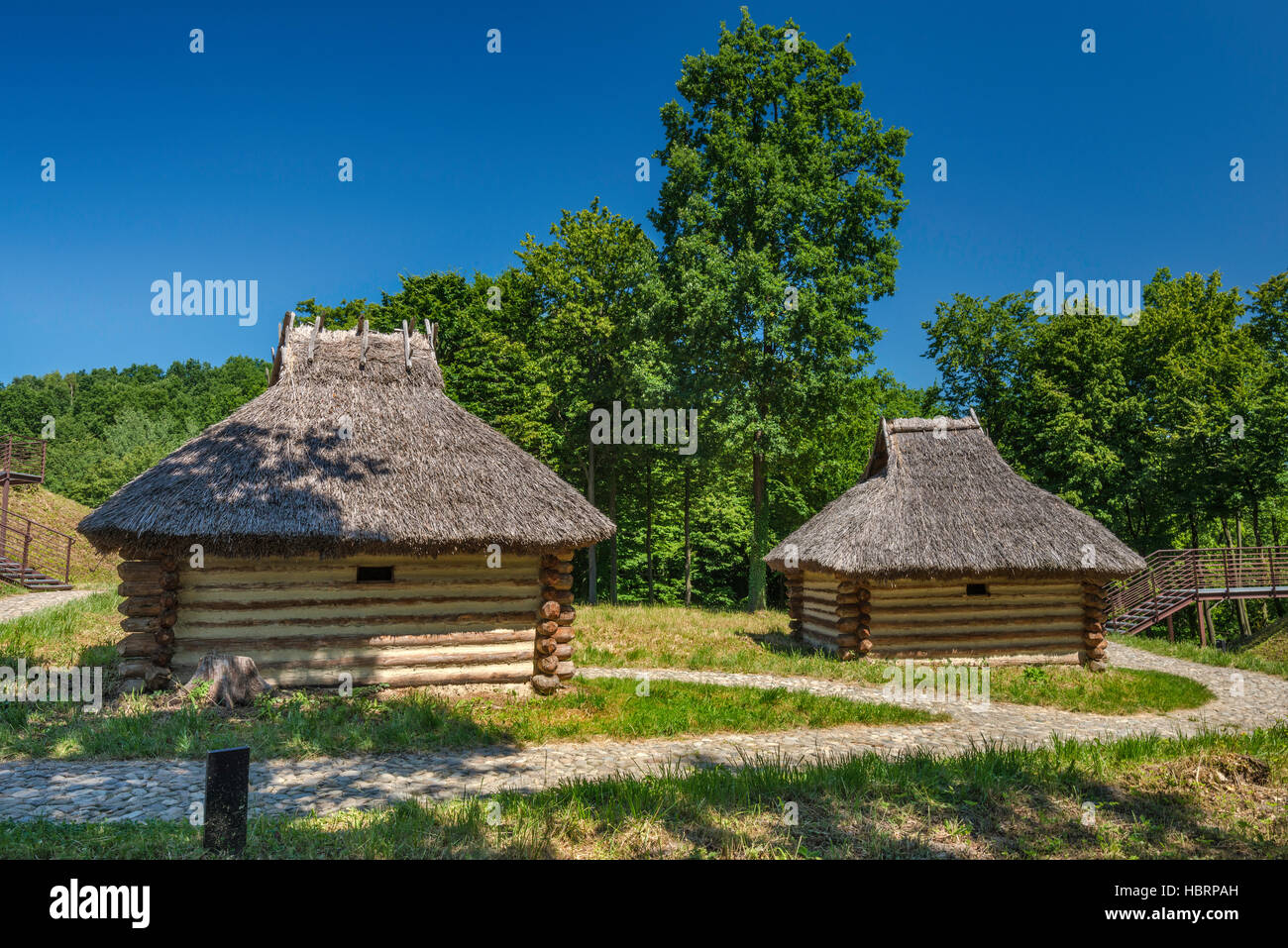 Medieval log cottages, 8th-10th century, reconstruction, Carpathian Troy Archaeological Open-Air Museum in Trzcinica, - Stock Image