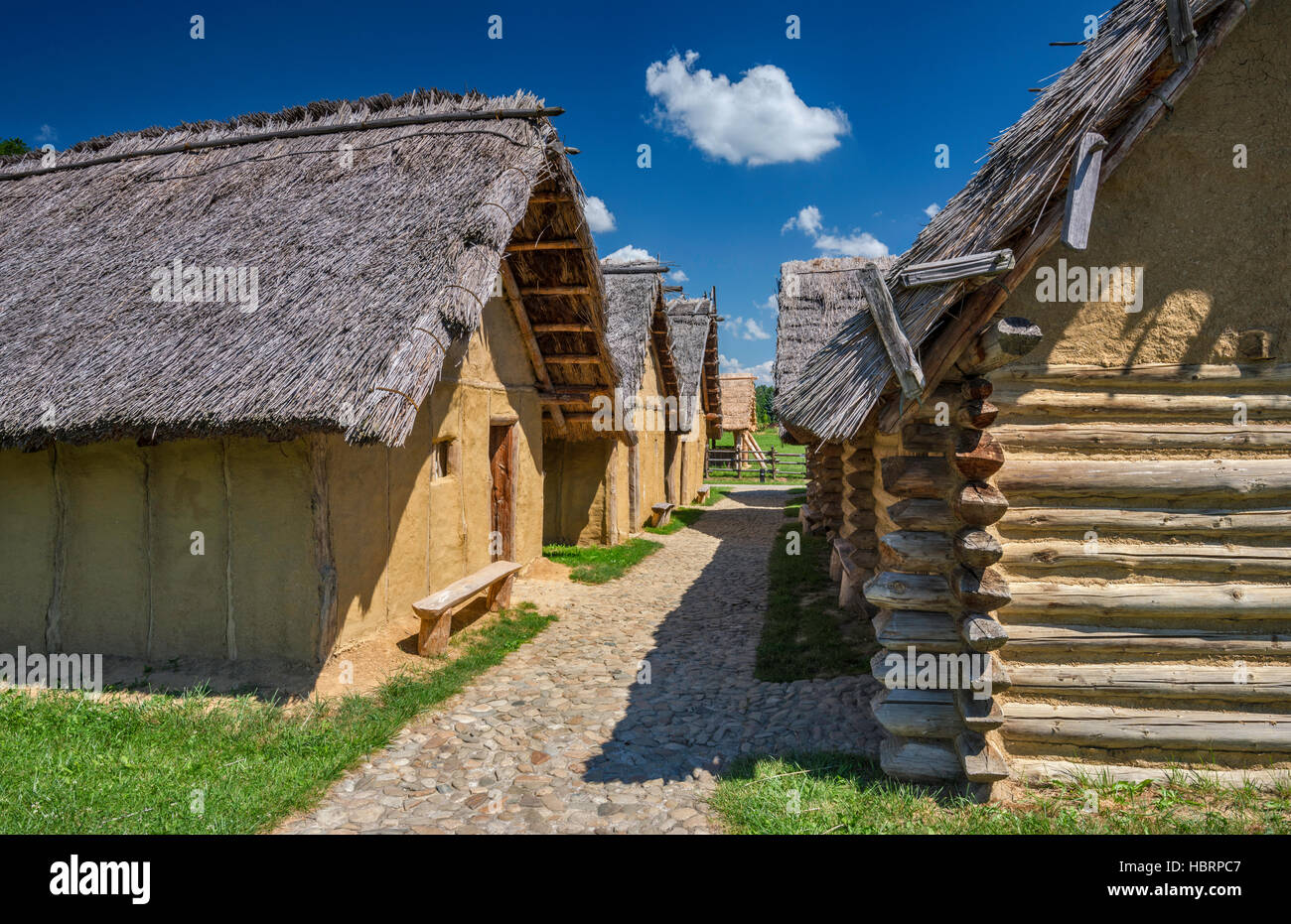 Otomani culture cottages, Bronze Age, 17th-14th century BC, Carpathian Troy Archaeological Open-Air Museum in Trzcinica, - Stock Image