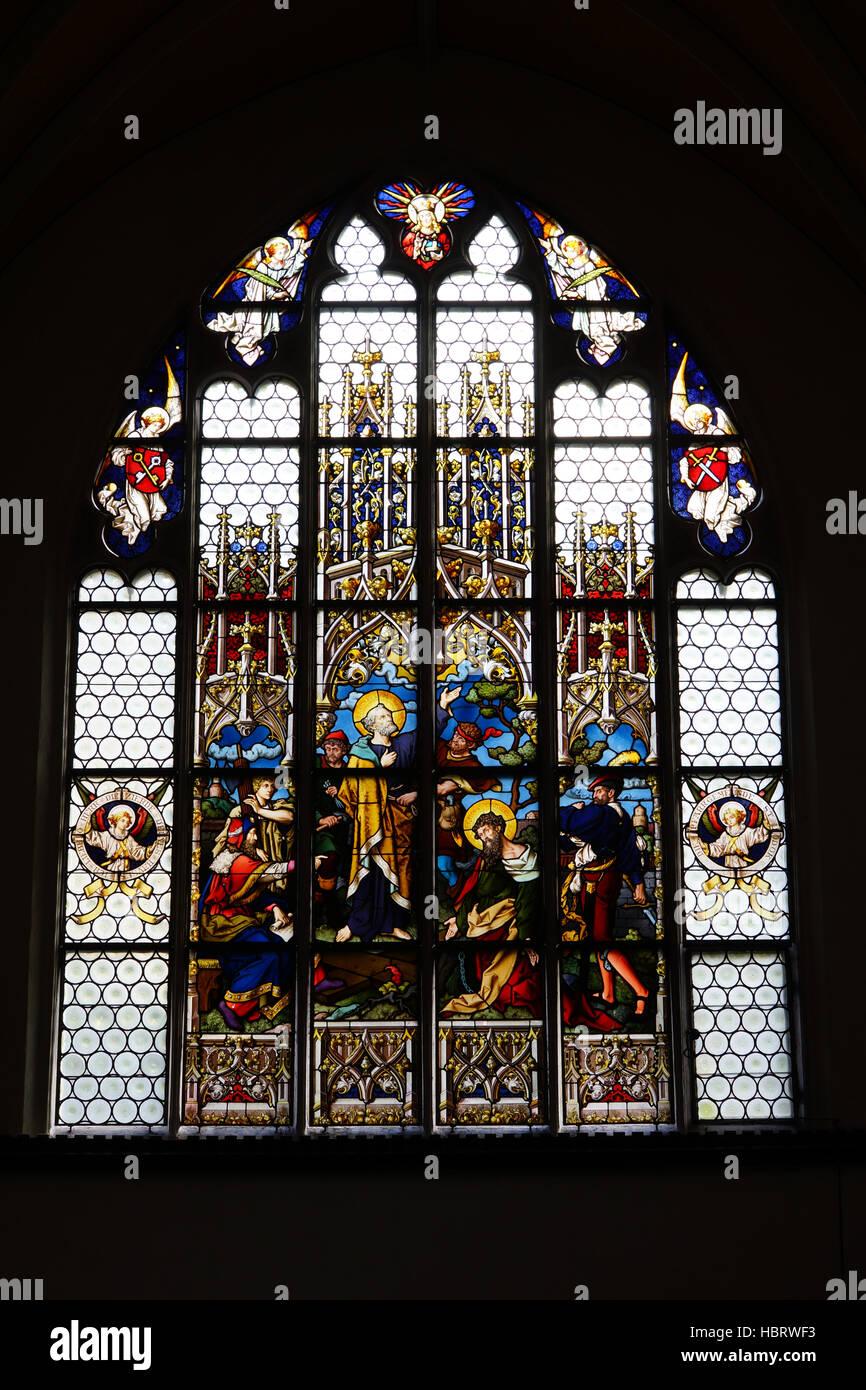 stained-glass window in St. Jodok Stock Photo