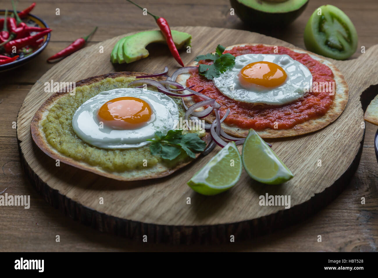 Variety of colorful mexican cuisine breakfast dishes on a wooden table Stock Photo