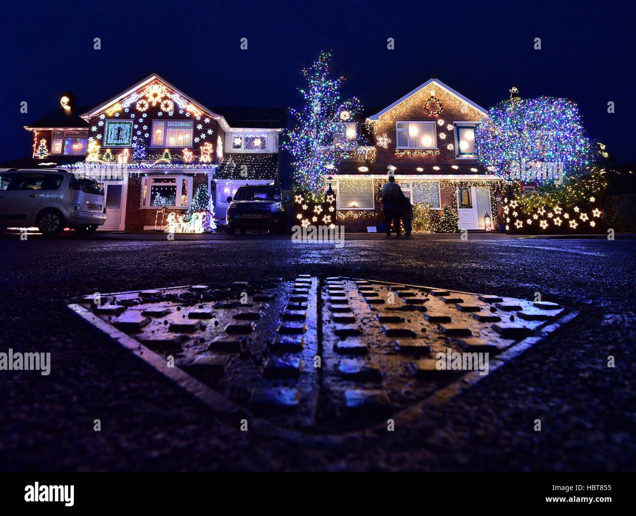 Christmas Lights On Houses.People Admire Christmas Lights On Houses On Trinity Close In