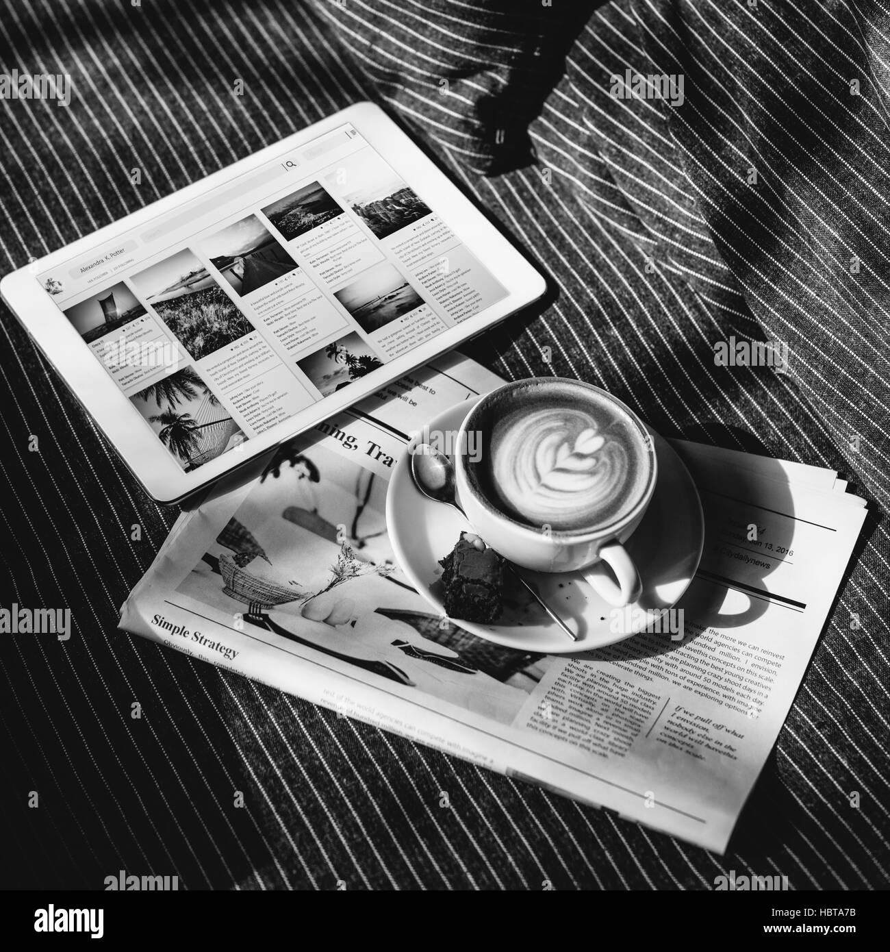 Coffee Americano Espresso Newspaper Couch Brownie Digital Tablet Concept - Stock Image