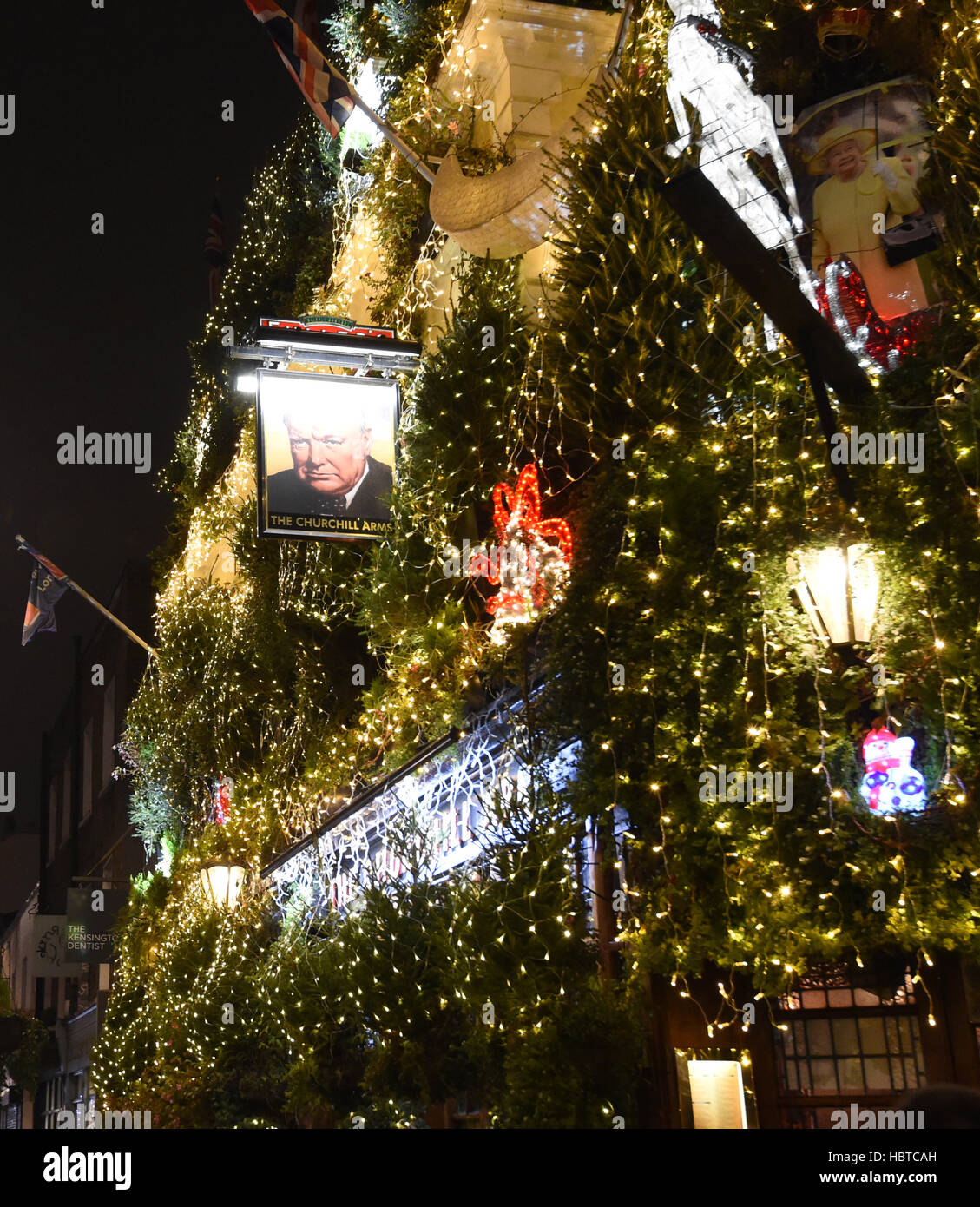 A General View Of Christmas Decorations Outside The Churchill Arms Pub Which Has Been Adorned With 85 Trees On Its Walls