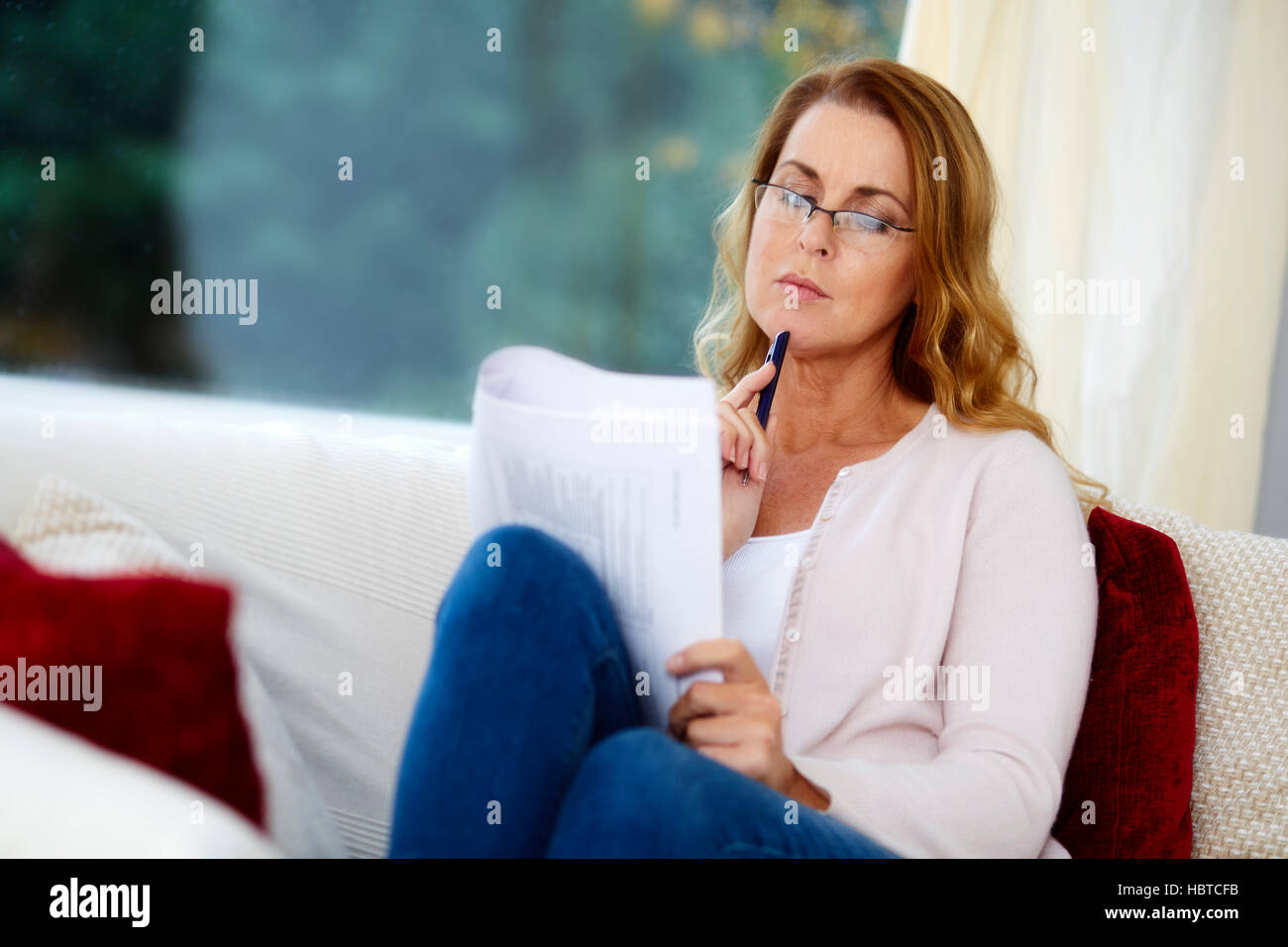 Thoughtful looking woman - Stock Image