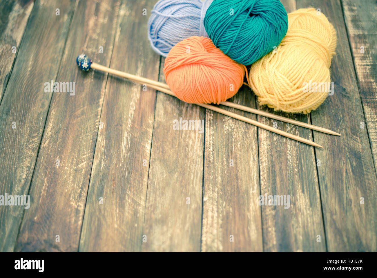 Yarn With Knitting Needles On Wooden Background Stock