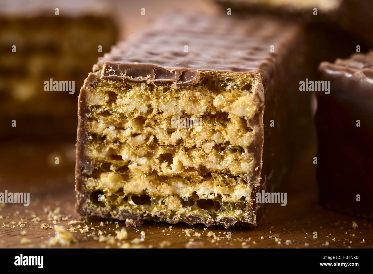 Chocolate covered wafer bar cross section closeup, photographed with natural light (Very Shallow Depth of Field) - Stock Image