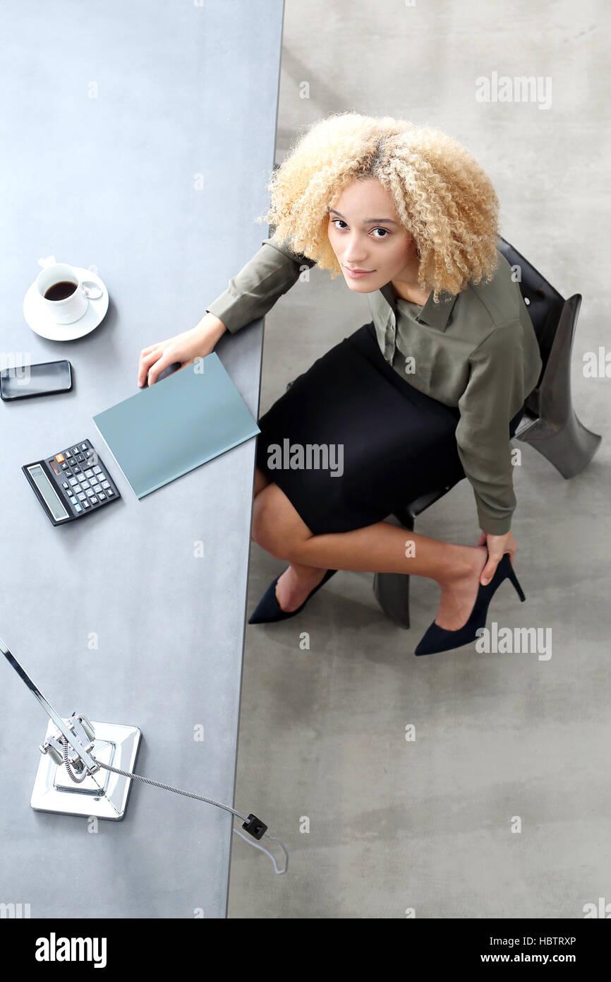 Foot massage. Aching feet. Woman massaging tired, aching feet. Stock Photo