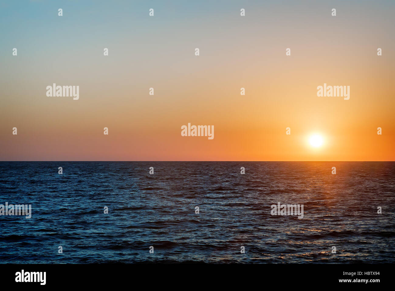 Landscape: sunsets on the sea. - Stock Image