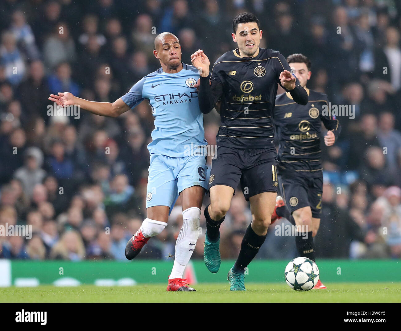 Manchester City's Fernando (left) and Celtic's Tom Rogic battle for the ball during the UEFA Champions League, - Stock Image