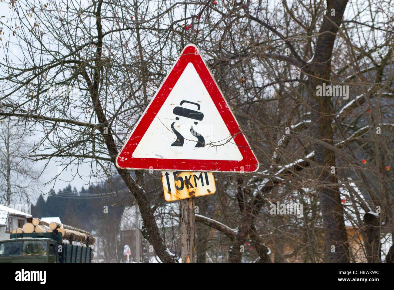 Road sign winter slipper road - Stock Image