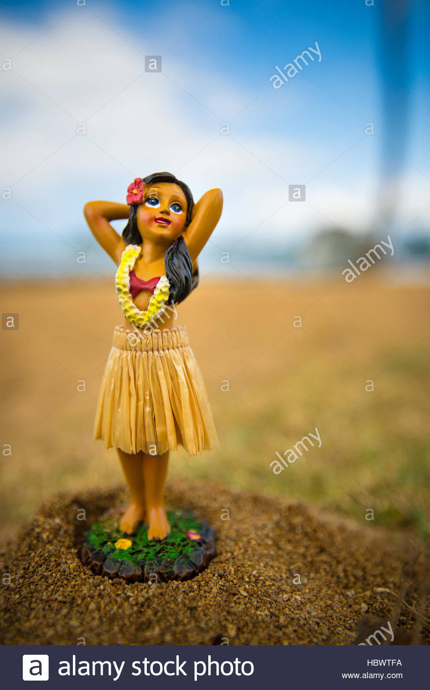 little hula dancer figure at the beach - Stock Image
