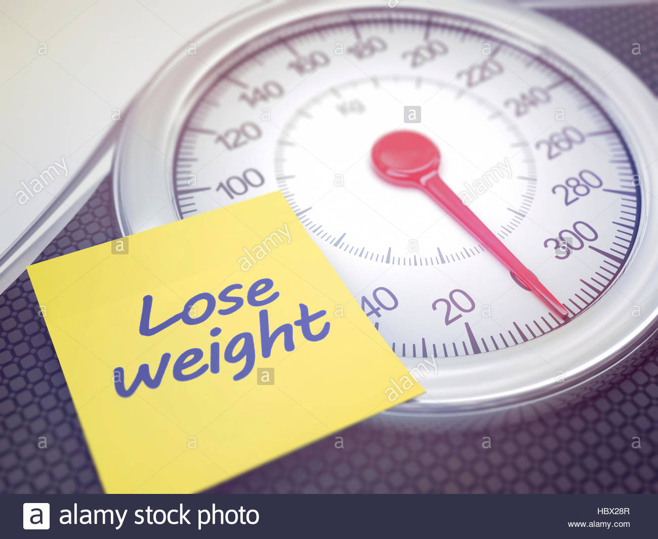 Weighing scales with note saying lose weight. - Stock Image