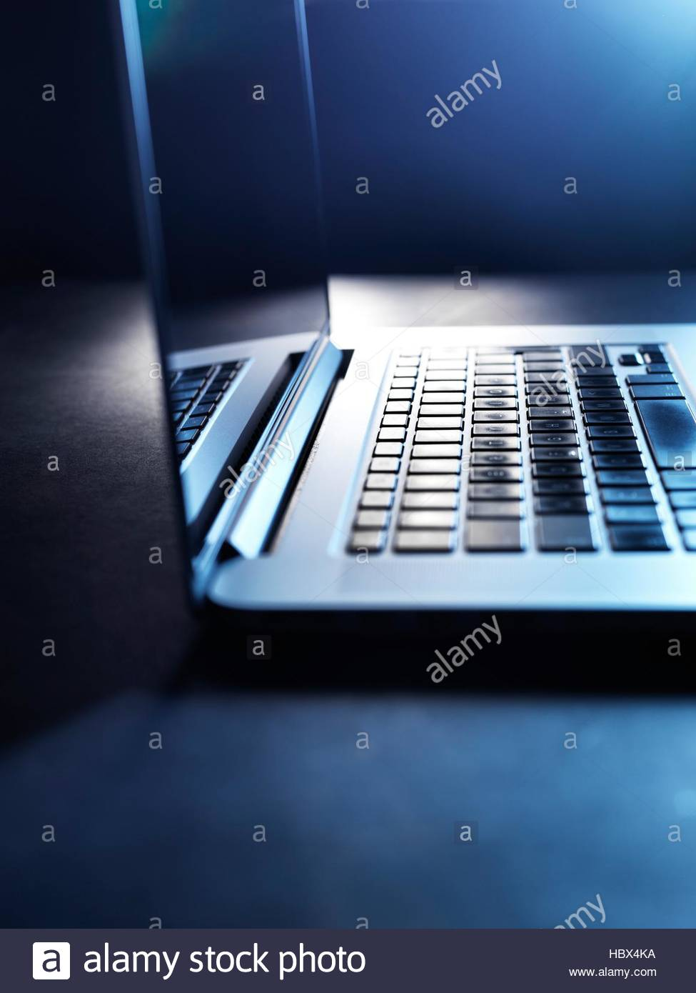 Typing on a laptop computer. - Stock Image