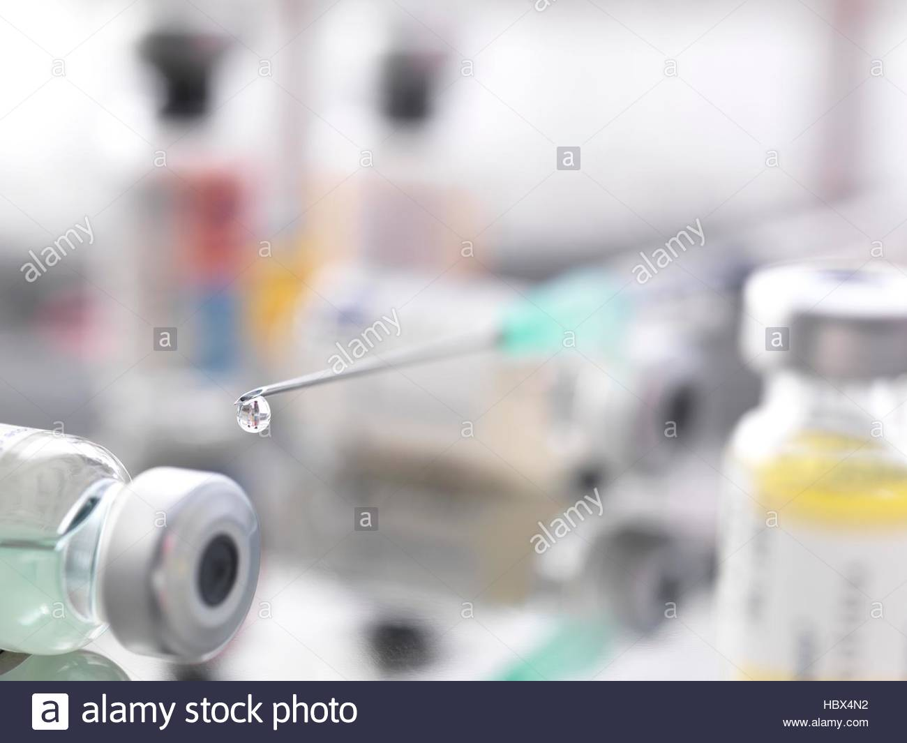 Syringe, vaccines and drugs vials. - Stock Image