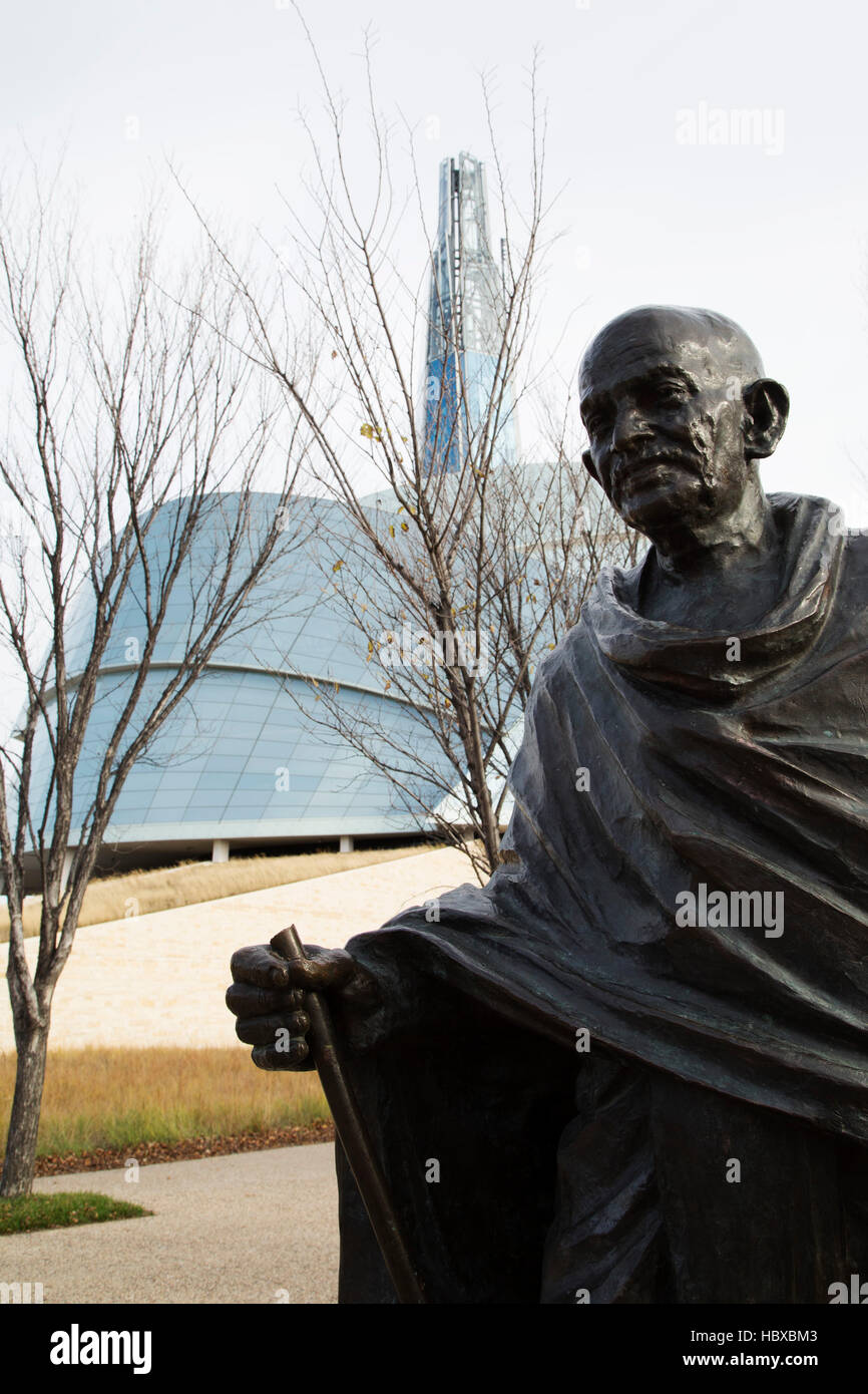 Mahatma Gandhi statue outside of the Canadian Museum for Human Rights in Winnipeg, Canada. - Stock Image