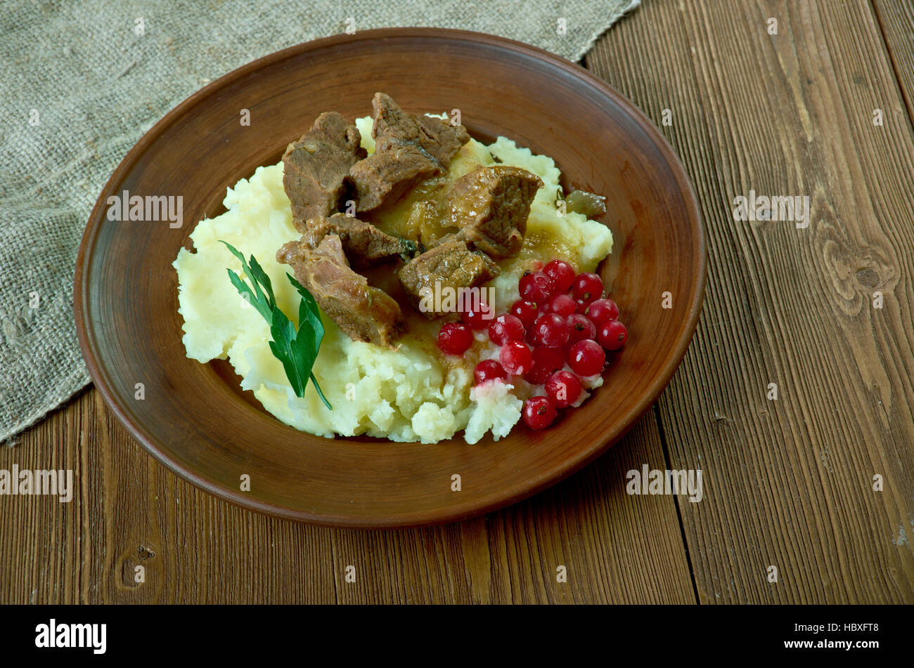 Sauteed reindeer venison steak served with mashed potatoes and lingonberry  -   traditional meal from Lapland, especially - Stock Image