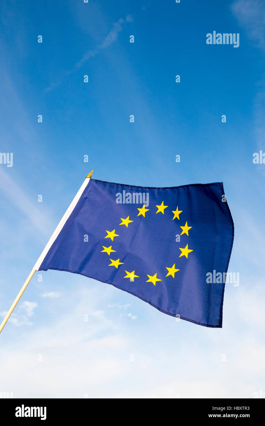 European Union flag flying in front of bright blue sky - Stock Image