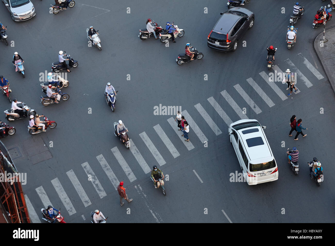 Motorcycles, cars, and pedestrian crossing at Ben Thanh roundabout, Ho Chi Minh City (Saigon), Vietnam Stock Photo