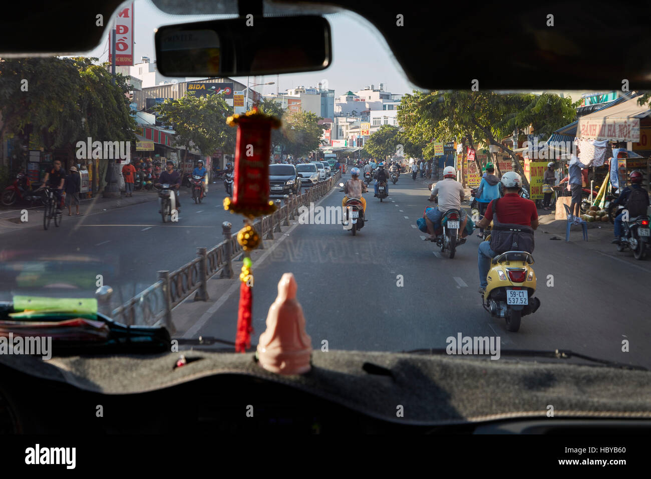 Motorcycles on busy street, Ho Chi Minh City (Saigon), Vietnam - Stock Image