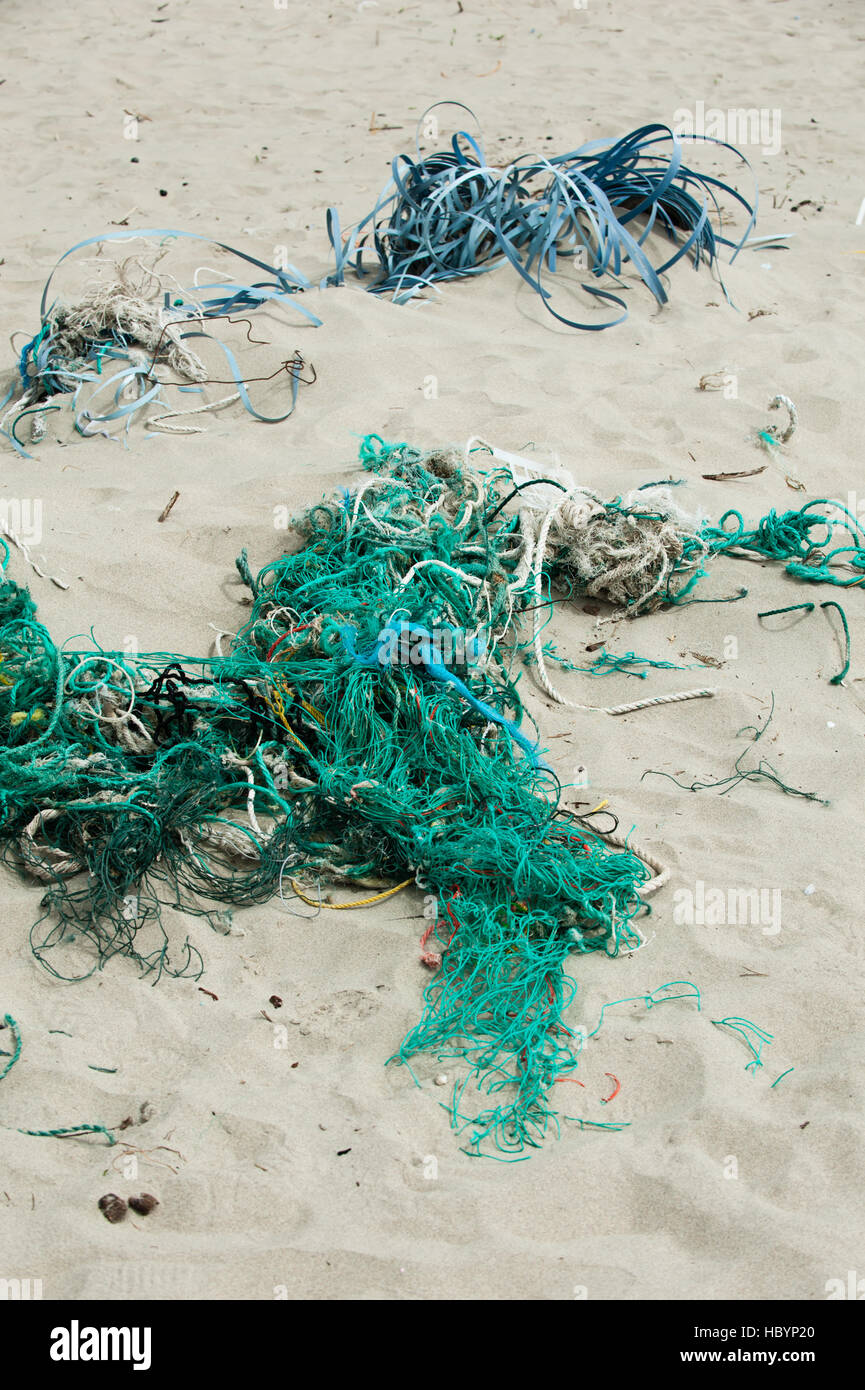 Plastic twine and rope litter the beach at Pacific City, Oregon. - Stock Image