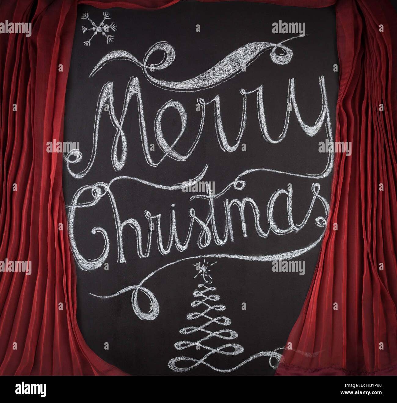 Merry Christmas hand drawn lettering with chalk on blackboard framed ...