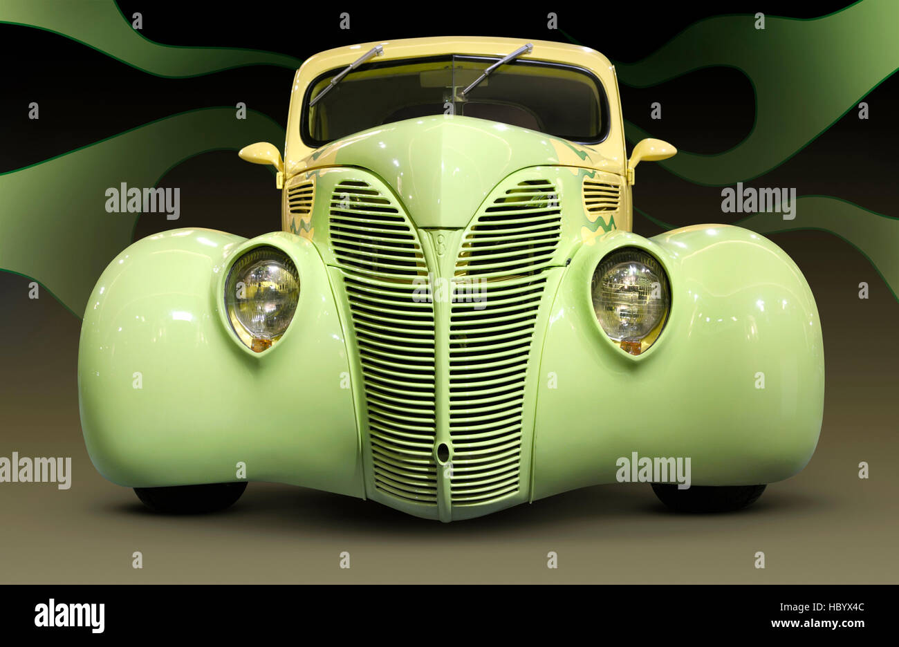 Yellow green Hot Rod Ford Coupe 1938 retro car with flame pattern painted on it, front view Stock Photo