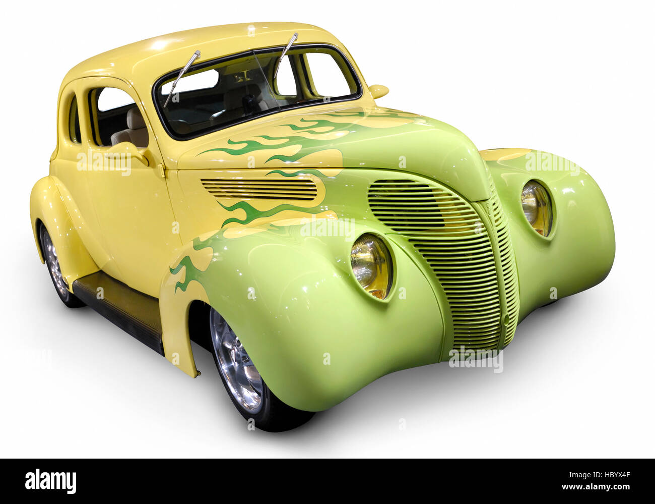 Yellow green Hot Rod Ford Coupe 1938 retro car with flame pattern painted on it Stock Photo