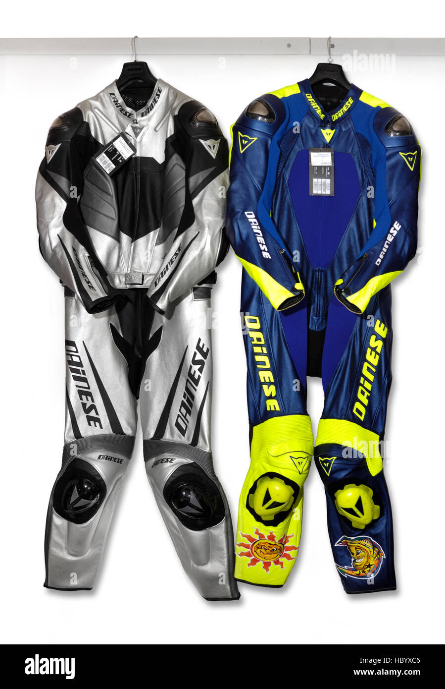Motorcyclist sports suits hanging on a wall - Stock Image