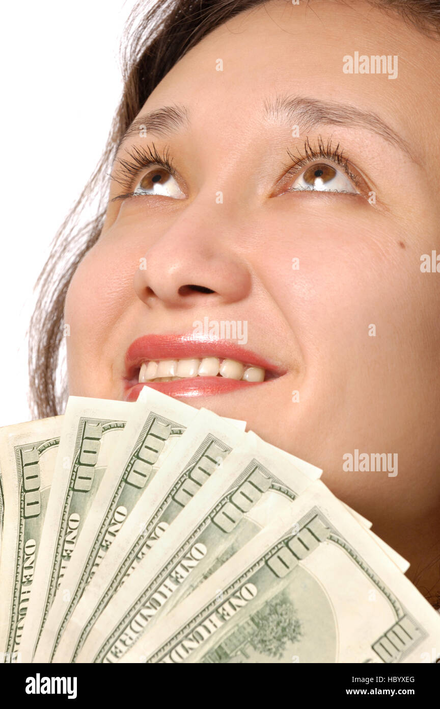 Happy woman holding hundred dollar bills in her hands - Stock Image