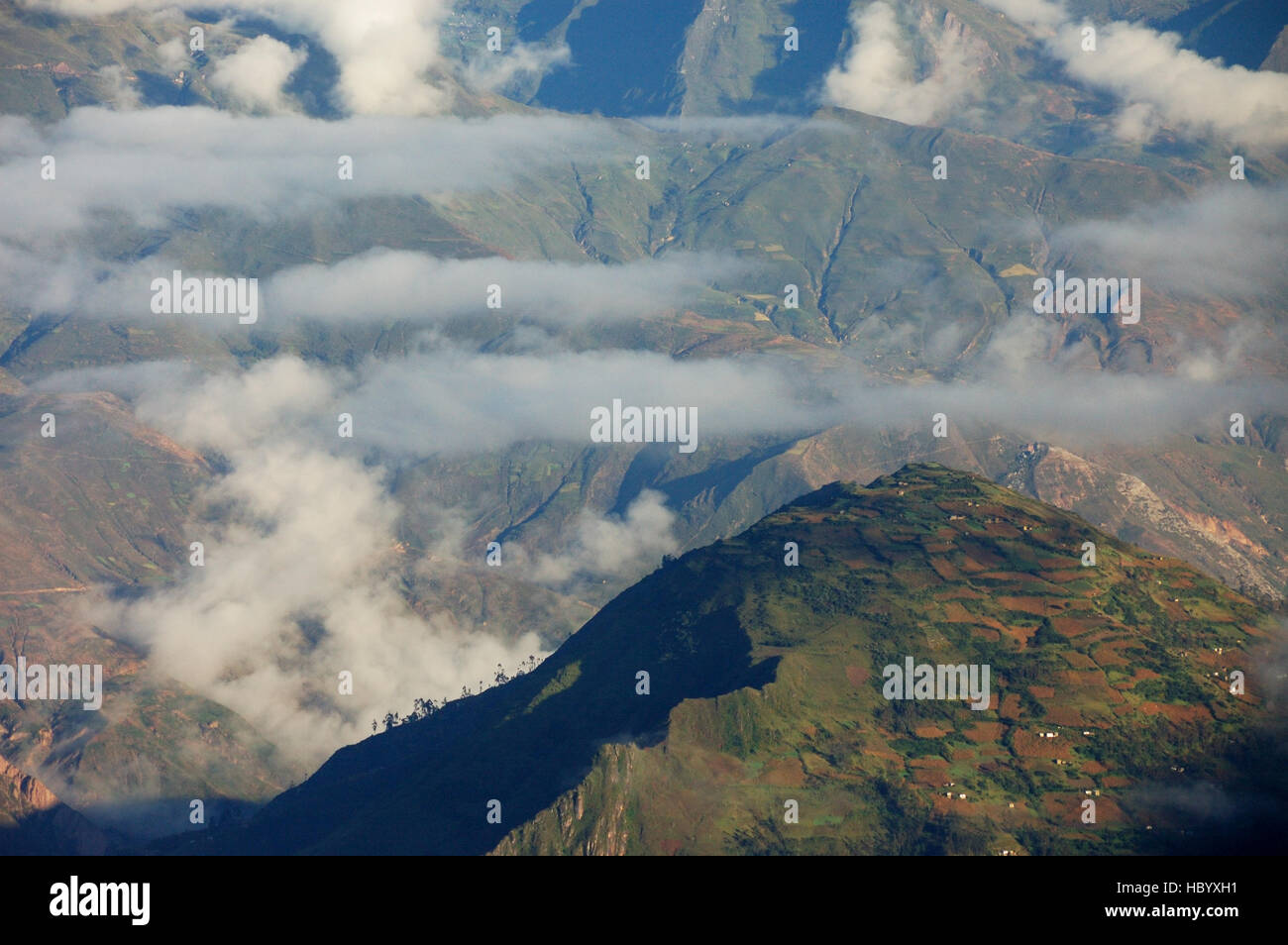 Foothills in the clouds, seen from Laguna Chillata near Mt. Illampu, Bolivia, South America - Stock Image