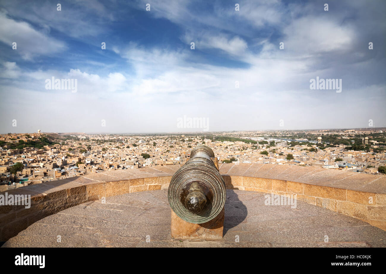 Old Cannon at tower of Jaisalmer fort and sandstone desert city view in Rajasthan, India - Stock Image